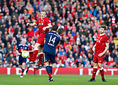 24th March 2018, Anfield, Liverpool, England; LFC Foundation Legends Charity Match 2018, Liverpool Legends versus FC Bayern Legends; Dirk Kuyt of Liverpool Legends rises above Xabi Alonso of Bayern Munich Legends
