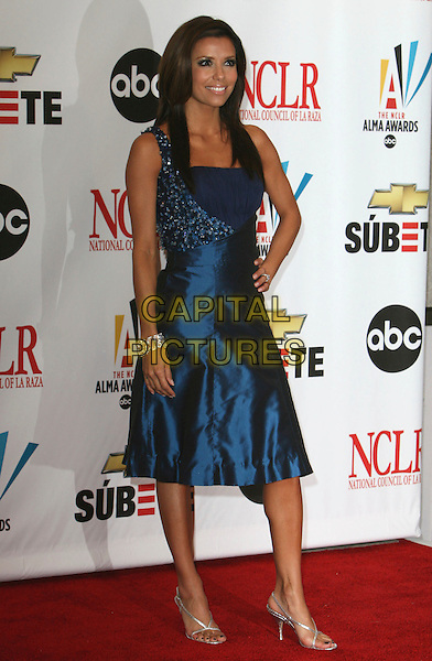 EVA LONGORIA.2007 NCLR ALMA Awards - Press Room held at the Pasadena Civic Center, Pasadena, California, USA..June 1st, 2007.full length blue satin one shoulder dress hand on hip.CAP/ADM/CH.©Charles Harris/AdMedia/Capital Pictures *** Local Caption *** .