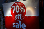 Up to 70% off sale sign in shop window, January sales 2009, Ipswich, England