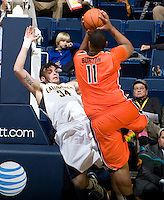 Joe Burton of Oregon State bumps Robert Thurman of California to the ground during the game at Haas Pavilion in Berkeley, California on January 31st, 2013.  California defeated Oregon State, 71-68.
