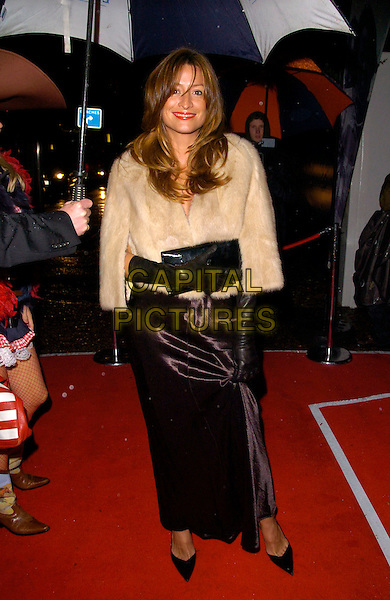 REBECCA LOOS.The Red Cross London Ball, The Room By The River, London, England..November 21st, 2007.full length black skirt gloves clutch bag purse white cream fur jacket .CAP/CAN.©Can Nguyen/Capital Pictures