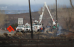 Crews work to restore power after a wind-driven brush fire raced through Pleasant Valley, south of Reno, Nev., on Friday, Jan. 20, 2012. (AP Photo/Cathleen Allison)