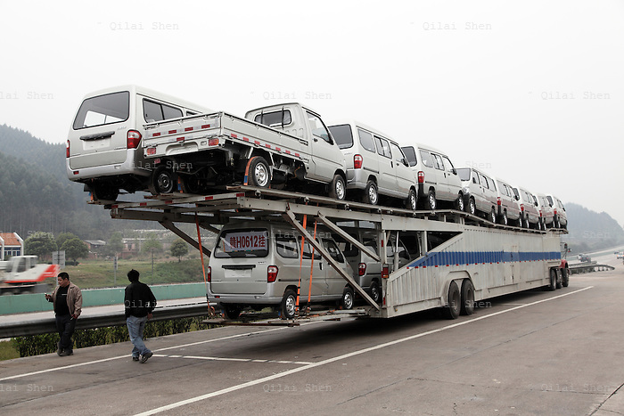 A truck hauling SAIC-GM Wuling mini-vans parks   at  a highway rest stop near Liuzhou, China,on 12 March 2010. Wuling's mini-commercial vehicles topped sales in China last year with over one million units sold.