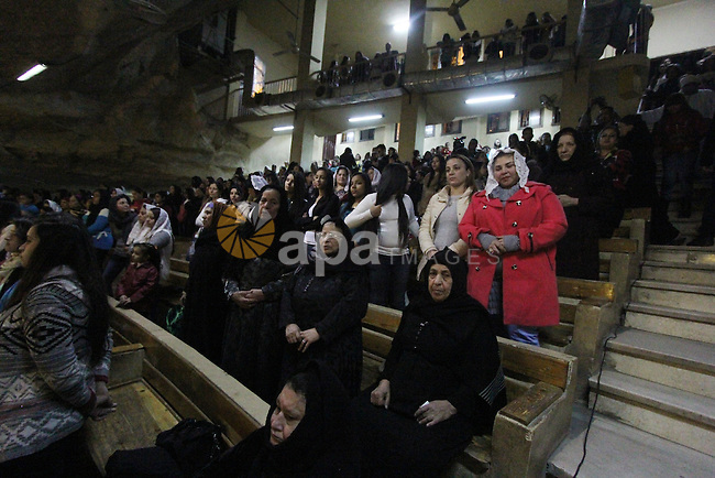 Egyptian Christians take part in the Coptic Orthodox Christmas Eve mass in Deir Simon Church in Cairo on January 6, 2016. Photo by Stringer