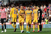 Sam Morsy (No 5) walks towards the Wigan dressing room after being shown a red card during Brentford vs Wigan Athletic, Sky Bet EFL Championship Football at Griffin Park on 15th September 201
