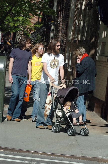 WWW.ACEPIXS.COM . . . . .  ....NEW YORK, MAY 9, 2005....Chris Robinson and Kate Hudson, armed with a digital Leica, stroll their child through the streets of the West Village taking pictures of photographers on their way.....Please byline: Philip Vaughan -- ACE PICTURES.. *** ***..Ace Pictures, Inc:  ..Craig Ashby (212) 243-8787..e-mail: picturedesk@acepixs.com..web: http://www.acepixs.com