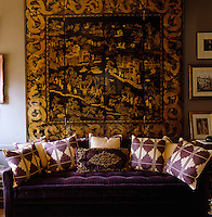 The study is dominated by a large Chinese screen arranged behind a sofa designed by Nicolo Castellini