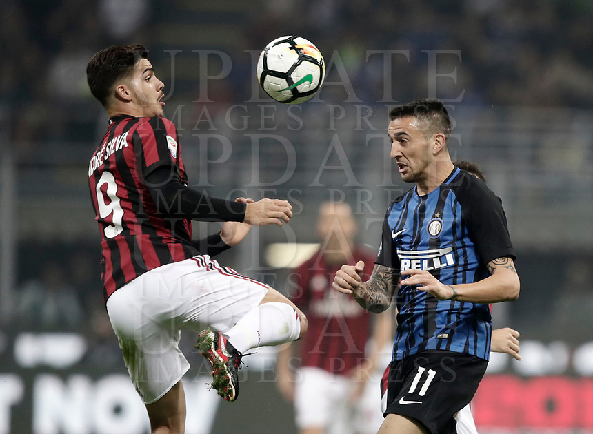 Calcio, Serie A: Milano, stadio Giuseppe Meazza, 15 ottobre 2017.<br /> Milan's André Silva (l) in action with Matias Vecino (r) during the Italian Serie A football match between Inter and Milan at Giuseppe Meazza (San Siro) stadium, October15, 2017.<br /> UPDATE IMAGES PRESS/Isabella Bonotto