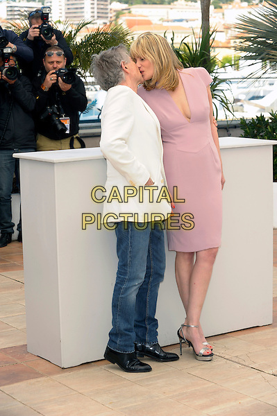 Roman Polanski, Emmanuelle Seigner.'La Venus A La Fourrure'  photocall at the 66th Cannes Film Festival, France 23rd May 2013.full length white suit jacket side profile kiss kissing jeans denim pink dress.CAP/PL.©Phil Loftus/Capital Pictures.