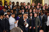 United States President Barack Obama (left) makes his exit after standing for a photo with the Alabama Crimson Tide football team during a ceremony to honor their 2015- 2016 College Football Playoff National Championship, in the East Room at The White House in Washington, D.C., Wednesday, March 2, 2016.<br /> Credit: Rod Lamkey Jr. / Pool via CNP
