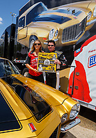 Jul 8, 2017; Joliet, IL, USA; NHRA top fuel driver Leah Pritchett and Papa Johns Pizza founder John Schnatter during qualifying for the Route 66 Nationals at Route 66 Raceway. Mandatory Credit: Mark J. Rebilas-USA TODAY Sports