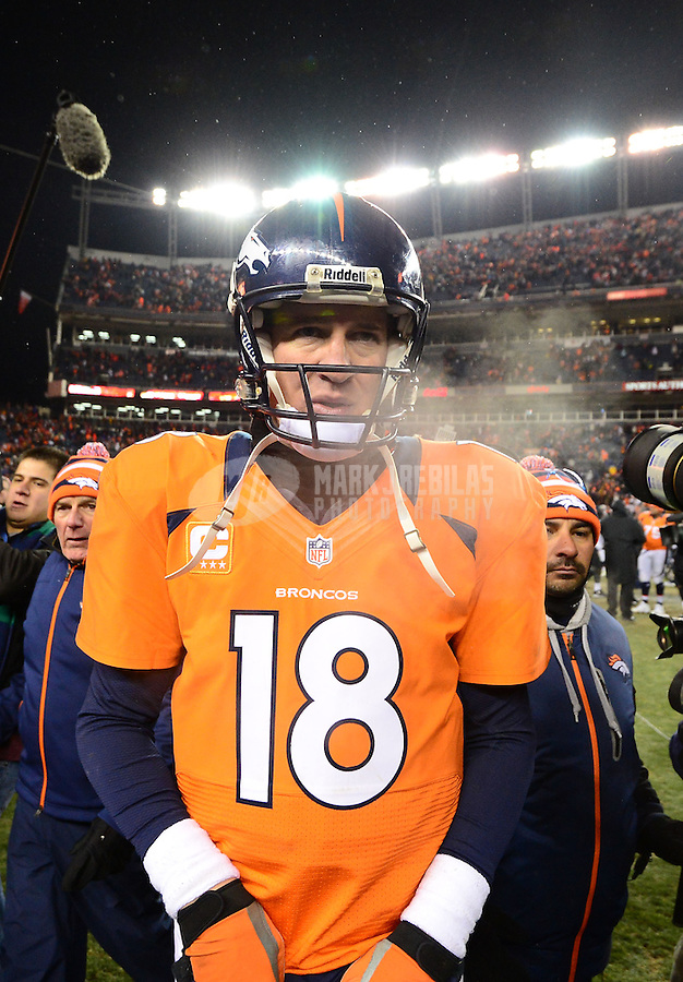 Jan 12, 2013; Denver, CO, USA; Denver Broncos quarterback Peyton Manning (18) following the game against the Baltimore Ravens during the AFC divisional round playoff game at Sports Authority Field.  Mandatory Credit: Mark J. Rebilas-