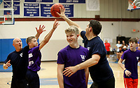 NWA Democrat-Gazette/DAVID GOTTSCHALK  Joseph McClung (from right), assistant principal at Woodland Junior High School, reaches Friday, May 19, 2017, around Josh Papania (cq), an eighth grade student, to block the shot of Tuck Crider, a seventh grade student, during the annual Student versus Faculty basketball game at the school gym in Fayetteville. The basketball game was part of the End of Year Celebration that included pies in the faces of administrators, the signing of year books and the basketball game among other activities. The students played with five players and the faculty played with four players on the court.