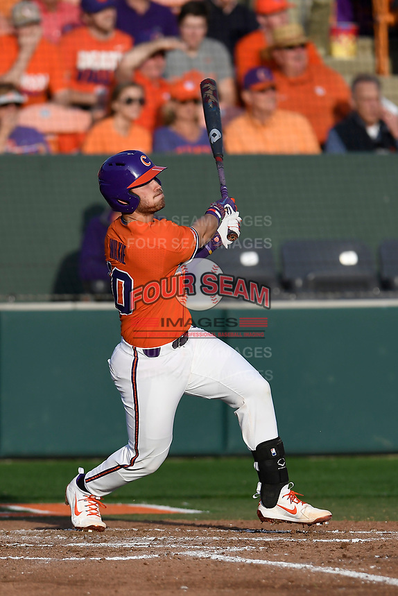 Catcher Kyle WIlkie (10) of the Clemson Tigers bats in a game against the William and Mary Tribe on February 16, 2018, at Doug Kingsmore Stadium in Clemson, South Carolina. Clemson won, 5-4 in 10 innings. (Tom Priddy/Four Seam Images)
