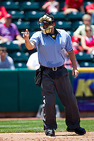 Home Plate Umpire Brandon Misun calls a strike during a game between the San Antonio Missions and the Springfield Cardinals on May 30, 2011 at Hammons Field in Springfield, Missouri.  Photo By David Welker/Four Seam Images.
