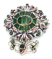 BNPS.co.uk (01202 558833)<br /> Pic: KidsonTrigg/BNPS<br /> <br /> £5000 - C17th free cut foil backed emerald & enamel pendant possibly of Hungarian manufacture in pierced gold mount, enamel & lapis lazuli.<br /> <br /> Frozen Assets - Over a £100,000 of Renaissance era jewellry found under a frozen joint of lamb in a run down chalet bungalow is coming up for auction.<br /> <br /> Amazed auctioneers found the hidden gems in the ramshakle hoarders freezer near Uffington in Wiltshire - where the canny late owner had gone to great lengths to protect her precious haul.<br /> <br /> However, the hidden stash wasn't the result of a bank heist but belonged to an eccentric collector who amassed the items in the 1960s - and kept the receipts to prove it.<br /> <br /> She passed away recently and her family brought in experts to hunt out relics they knew their relative had hidden away over the years.