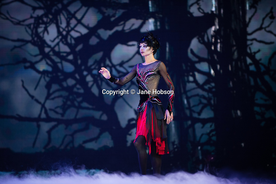 London, UK. 18.05.2012. Swan Lake on Ice opens at the Royal Albert Hall, London. Picture shows: Olena Pyatash (Odile -Black Swan), Olga Sharutenko (Odette -White Swan), Andrey Penkin (Siegfried).