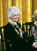 Actress and singer Mary Martin listens as first lady Barbara Bush makes remarks during a ceremony for 1989 Kennedy Center Honorees in the East Room of the White House, December 3, 1989 in Washington, DC. The 1989 honorees are: actress and singer Mary Martin, dancer Alexandra Danilova, singer and actor Harry Belafonte, actress Claudette Colbert, and composer William Schuman.<br /> Credit: Peter Heimsath / Pool via CNP