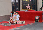 Lucy Liu Honored With Star On The Hollywood Walk Of Fame on May 01, 2019 in Hollywood, California.<br /> a_Lucy Liu 036 and son