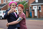 © Joel Goodman - 07973 332324 . 10/06/2016 . Manchester , UK . Comedian EDDIE IZZARD (left) meets resident (and fan) RACHEL MORRIS (right) when door knocking in Hulme , Manchester , in support of the Remain campaign , ahead of the UK's EU Referendum . Photo credit : Joel Goodman