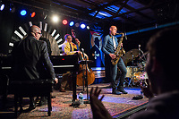 Joshua Redman plays the tenor saxophone with the Ethan Iverson Trio for Thelonious Monk's 100th birthday during the Monk @ 100 festival at the Durham Fruit and Produce Company in Durham, NC Wednesday, October 25, 2017. (Justin Cook for The New York Times)