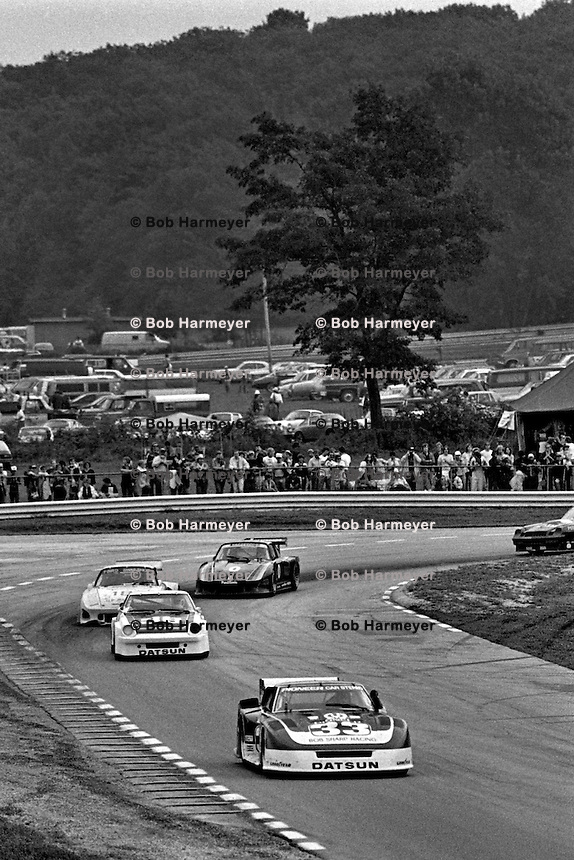 The Datsun 280ZX Turbo driven by Sam Posey and Paul Newman leads a group of cars out of Turn 5 during a Camel GT IMSA race at Road America near Elkhart Lake, Wisconsin, on August 31, 1980. (Photo by Bob Harmeyer)