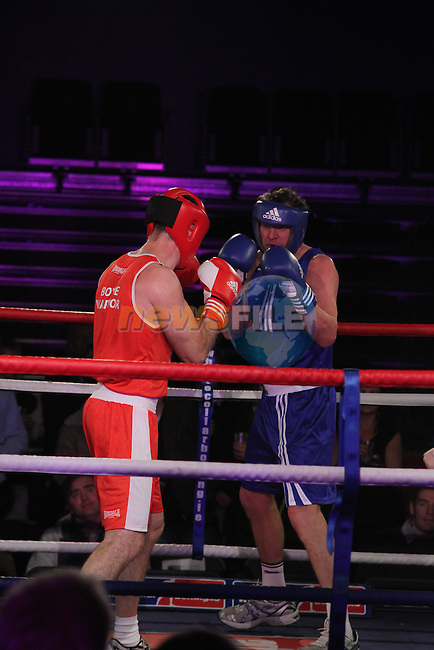 """John O'Brien """"The Boyne Warrior"""" (red) and Robbie Maher, """"The Real Hustler"""" (blue) sponsored by Glanbia Drogheda Dairies taking part in Drogheda and District, """"Battle of the Barbican"""" White Collar Boxing Event in aid of the Des Smyth Foundation...(Photo credit should read Jenny Matthews www.newsfile.ie)....This Picture has been sent you under the conditions enclosed by:.Newsfile Ltd..The Studio,.Millmount Abbey,.Drogheda,.Co Meath..Ireland..Tel: +353(0)41-9871240.Fax: +353(0)41-9871260.GSM: +353(0)86-2500958.email: pictures@newsfile.ie.www.newsfile.ie."""