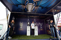 SWANSEA, WALES - APRIL 22: A young boy has his picture taken by the Champions League and Women's Champions League trophies on display outside the stadium prior to the Premier League match between Swansea City and Stoke City at The Liberty Stadium on April 22, 2017 in Swansea, Wales. (Photo by Athena Pictures/Getty Images)