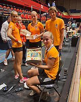The Netherlands, Den Bosch, 16.04.2014. Fed Cup Netherlands-Japan, practice, Richel Hogenkamp receives a birthday cake from Arantxa Rus (L) (NED) coach Raymond Knaap, Kiki Bertens (NED) , Michaela Krajicek (NED) and captain Paul Haarhuis  (NED)<br /> Photo:Tennisimages/Henk Koster