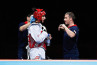 10 AUG 2012 - LONDON, GBR - Sarah Stevenson (GBR) (left) of Great Britain listens to her husband and coach Steve Jennings (right) during her women's -67kg category preliminary round contest against Paige McPherson during the London 2012 Olympic Games Taekwondo at Excel in London, Great Britain (PHOTO (C) 2012 NIGEL FARROW)