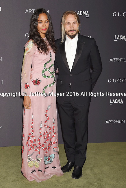 LOS ANGELES, CA - OCTOBER 29: Actress Zoe Saldana (L) and artist Marco Perego attend the 2016 LACMA Art + Film Gala honoring Robert Irwin and Kathryn Bigelow presented by Gucci at LACMA on October 29, 2016 in Los Angeles, California.