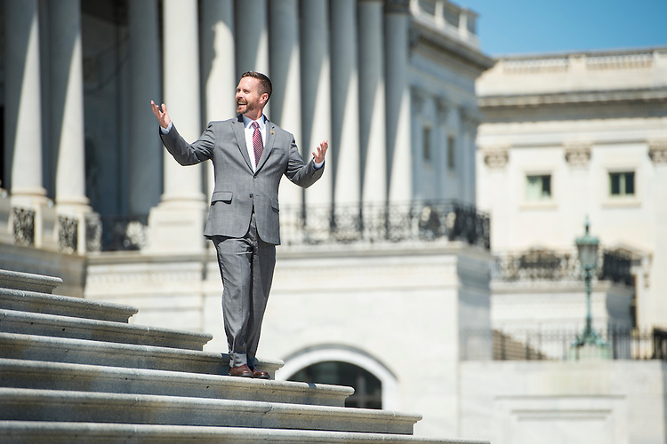 UNITED STATES - SEPTEMBER 11: Rep. Rodney Davis, R-Ill., jokes with other members as he walks down the House steps at the Capitol following the final vote of the week on Friday, Sept. 11, 2015. (Photo By Bill Clark/CQ Roll Call)