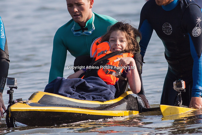 COPY BY TOM BEDFORD<br /> Pictured: Poppy Jones testing out the special boat for the triathlon.<br /> Re: A very special father-and-daughter team have tackled the Cardiff Triathlon on Sunday 26 June 2016.<br /> Poppy Jones, 11, who will be competing alongside dad Rob Jones, wants to win the event.<br /> And she's not going to let the fact that she has quadriplegic cerebral palsy , which means she can't sit, stand, roll or support herself, and chronic lung disease stop her.<br /> She will be by Rob's side every step of the way thanks to a cutting-edge wheelchair and boat – for Rob to push or pull – designed especially for the event, which sees participants take part in a swim across Cardiff Bay , a run and a bike ride.