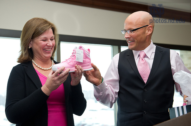 Feb. 2, 2013; College of Science Dean Greg Crawford presents Mary Hesburgh Flaherty a pair of pink shoes at the annual Pink Zone lunch at Club Naimoli. ..Photo by Matt Cashore/University of Notre Dame.