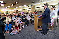 Former Congressman and Fox News host John Kasich and wife address a gathering of fans before he signed copies of his new book, &quot;Stand for Something&quot;, in the Westerville Public Library reproduction of his Washington office. The library opened Sunday, June 11, 2006, the offices containing Kasich's historical records and personal library from his years as a U.S. congressman.<br />