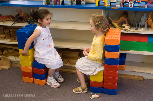 Berkeley CA  Four-year-olds in social interaction, enjoying block thrones they've created at bilingual, Spanish-English preschool