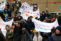 The banners approach the stadium as part of the Red, White & Black day procession in support of Charlton Athletic Race & Equality Partnership (CARE) during the Sky Bet League 1 match between Charlton Athletic and Fleetwood Town at The Valley, London, England on 17 March 2018. Photo by Carlton Myrie.