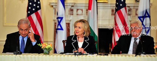 """United States Secretary of State Hillary Rodham Clinton makes closing remarks at the press event """"Relaunch of Direct Negotiations Between the Israelis and Palestinians"""" in the Benjamin Franklin Room of the U.S. Department of State on Thursday, September 2, 2010.  From left to right: Prime Minister Benjamin Netanyahu of Israel, United States Secretary of State Hillary Rodham Clinton, and President Mahmoud Abbas of the Palestinian Authority..Credit: Ron Sachs / CNP.(RESTRICTION: NO New York or New Jersey Newspapers or newspapers within a 75 mile radius of New York City)"""