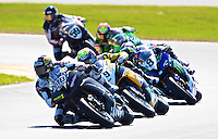 Jake Zemke (98) leads a pack of motorcycles during the Daytona 200 motorcycle race at Daytona International Speedway, Daytona Beach, FL, March 2011.(Photo by Brian Cleary/www.bcpix.com)