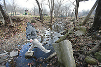 NWA Democrat-Gazette/J.T. WAMPLER Thomas Sayer of Fayetteville carefully crosses Skull Creek Monday Jan. 8, 2018. Sayer was spending some time outside at Wilson Park after being indoors during the recent frigid temperatures. The National Weather Service is calling for highs in the 50s the next few days.