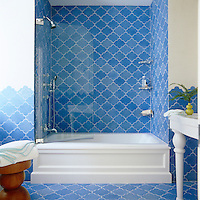 The cool tranquility of this bathroom is emphasised by its blue and white colour scheme and ceramic tiles