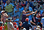 10 June 2012: Boston Red Sox fans try to catch a foul ball during a game against the Washington Nationals at Fenway Park in Boston, MA. The Nationals defeated the Red Sox 4-3 to sweep their 3-game interleague series. Mandatory Credit: Ed Wolfstein Photo