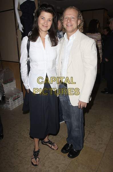 DAPHNE ZUNICA & BRUCE COHEN .The LA Gay & Lesbian Center's Breakfast At Barney's held At Barney's Greengrass, Beverly Hills, California, USA, 4th May 2010..full length shirt black sandals jeans skirt smiling white shirt beige cream .CAP/ADM/KB.©Kevan Brooks/AdMedia/Capital Pictures.