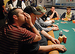 Jason Williams tells blind player, Hal Lubarsky, what is happening during play.  Lubarsky went deep in the tournament.