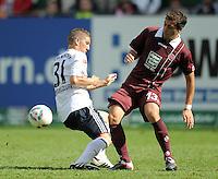 FUSSBALL   1. BUNDESLIGA  SAISON 2011/2012   4. Spieltag 1. FC Kaiserslautern - FC Bayern Muenchen         27.08.2011 Bastian Schweinsteiger (li, FC Bayern Muenchen) gegen Thanos Petsos (re, 1. FC Kaiserslautern)