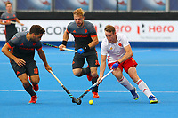 Christopher Griffiths of England and Valentin Verga of Netherlands compete for the ball during the Hockey World League Semi-Final match between England and Netherlands at the Olympic Park, London, England on 24 June 2017. Photo by Steve McCarthy.
