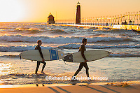 64795-01310 Surfers on beach near Grand Haven South Pier Lighthouse at sunset on Lake Michigan, Ottawa County, Grand Haven, MI