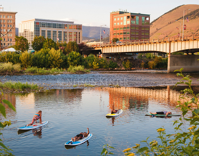 stand up paddle boards used in a yoga class on the clark fork river on a summer evening in downtown missoula, montana