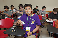 OrigamiUSA 2016 Convention at St. John's University, Queens, New York, USA. Creasers in Robert Lang's class on his design Classical Cicada. First timer, Kevin Ju, New Jersey, pauses to show his progress.