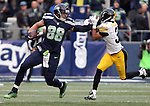 Seattle Seahawks tight end Jimmy Graham (88) stiff arms Pittsburgh Steelers cornerback Ross Cockrell (31) at CenturyLink Field in Seattle, Washington on November 29, 2015.  The Seahawks beat the Steelers 39-30.      ©2015. Jim Bryant Photo. All Rights Reserved.